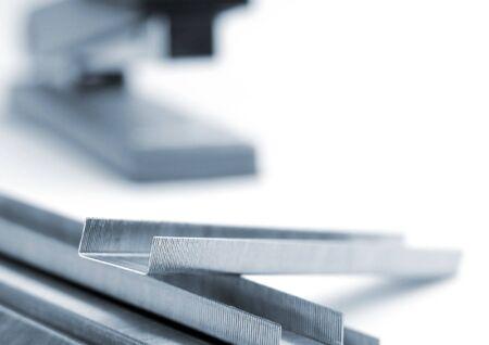 staples: Macro shot of office stapler and staples
