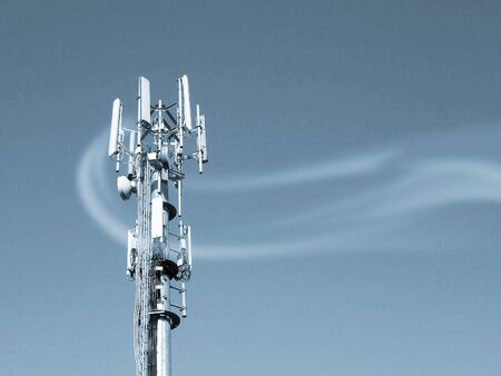 Closeup of transmitter tower overlaid with smoke effect. Blue toned. Stock Photo