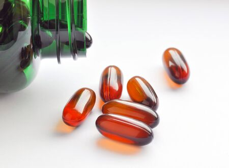 Close up of green bottle with flaxseed oil capsules Stock Photo - 6983080
