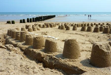 Sand castles on Bridlington beach on lazy sunny day photo