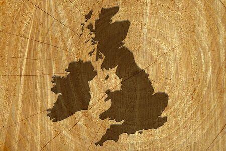 UK map on freshly cut tree showing wood texture photo