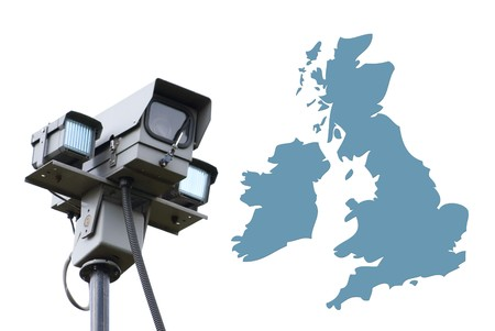 Surveillance camera overlooks outline map of UK Stock Photo - 7910542