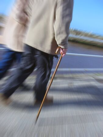 Elderly couple take a stroll with zoom effect Stock Photo - 7910544