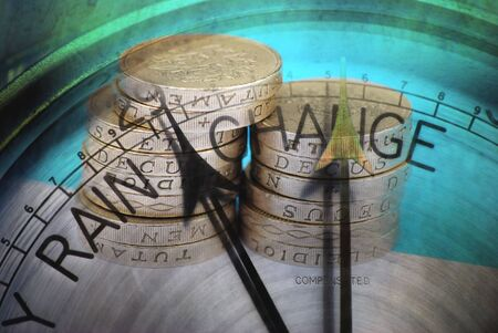 Stack of UK coins overlaid with barometer clock face Stock Photo - 8109042