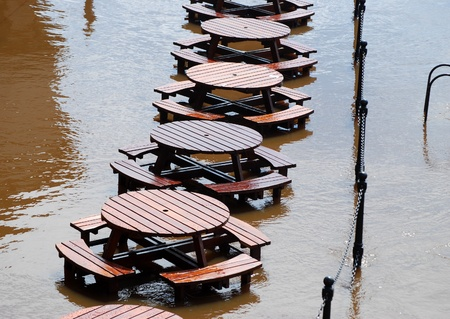 ouse: Flooded tables on riverside of Yorks River Ouse.