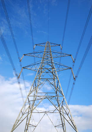View of electricity pylon with power lines photo