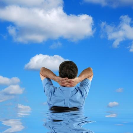 denier: Man sat in sunken chair against cloudy sky