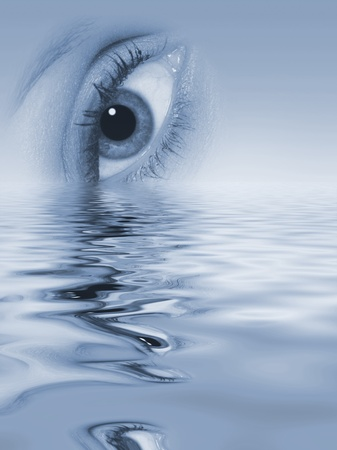 sinking: Womans eye sinking into water (toned blue). Stock Photo