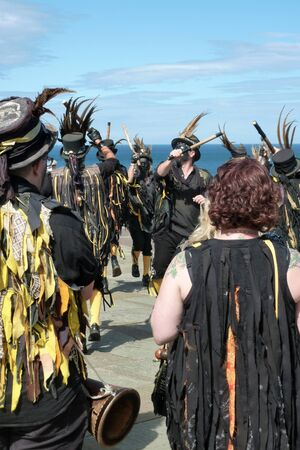 morris: Traditional Morris dancers performing in seaside town of Whitby.