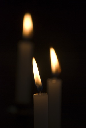 flickering: Closeup of flickering candles inside of church