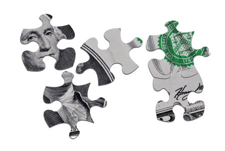 suggesting: Closeup of US Dollar banknote jigsaw pieces suggesting problems with currency