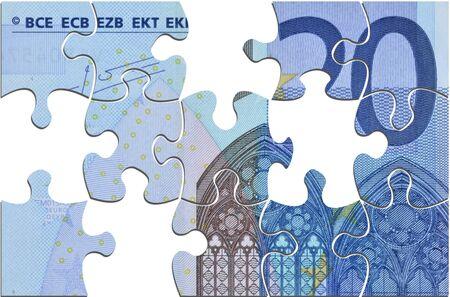 20 euro: Closeup of twenty euro banknote jigsaw puzzle signifying euro crisis