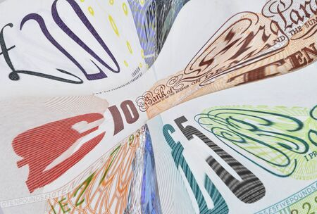distorted: English banknotes distorted to signify UK financial problems