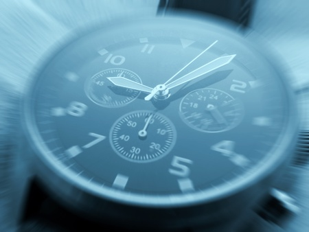 Closeup of watch face with zoom effect and cyan toned photo