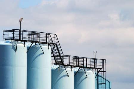 liquids: Telephoto view of storage tanks for liquids. Stock Photo
