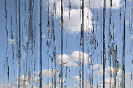 flaking: Flaking paint on wooden door overlaid with sky pattern. Unusual background for text or artwork. Stock Photo