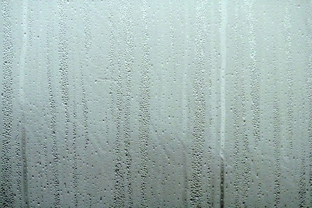 Water drops on steamed up window . Ideal for background and fills. Banco de Imagens