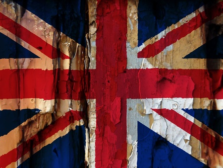 union jack: Unusual grunge type image show the British flag overlaid over flaky paint on old wooded door. Harsh colours used adds to the effect. Eye catching image has many uses.