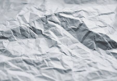 Closeup of crumpled paper toned blue. Ideal for unusual backgrounds. Stock Photo - 13197668