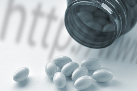 Online drugs concept showing pills and bottle with http;//www shadow Stock Photo - 13197650