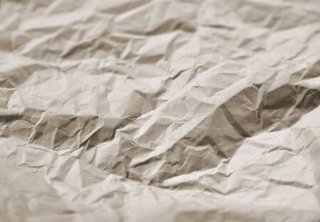 Closeup of crumpled paper toned brown. Ideal for unusual backgrounds. Stock Photo - 13197715