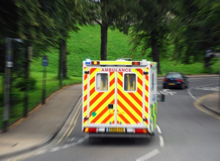View of ambulance reacting to 999 call  Zoom blur added for effect  Stock Photo