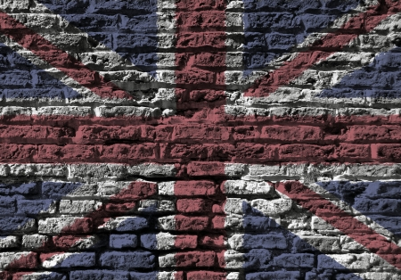 brick sign: Section of old brick wall foverlaid with Union Jack flag