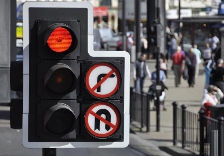 red traffic light: Red traffic light at road junction in city center