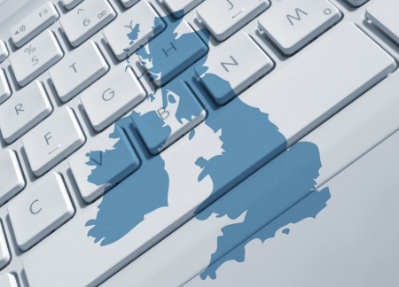 Closeup of laptop keyboard overlaid with UK map photo