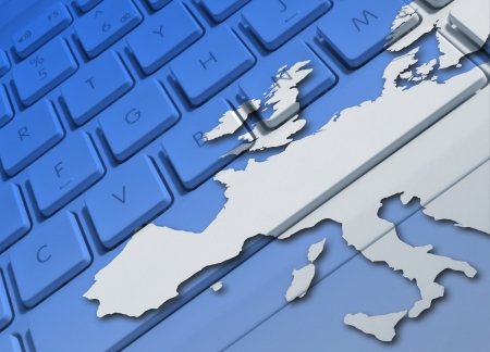 Closeup of laptop keyboard overlaid with Europe map photo