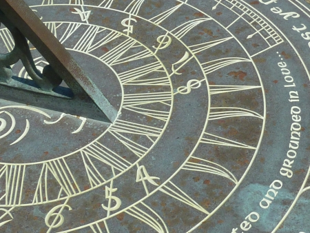 Closeup of the face of an old sundial  Stock Photo