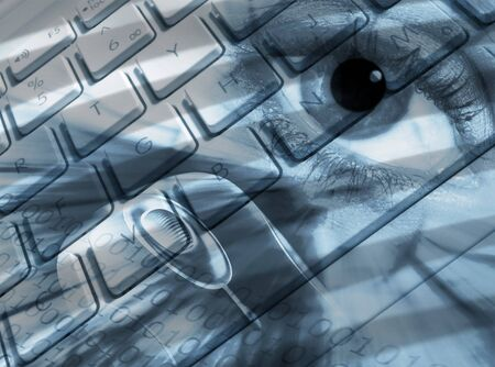 blue eye: Composite image showing laptop keyboard, mouse and eye