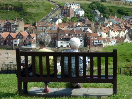 whitby: Couple sitting on bench overlooking Whitby view