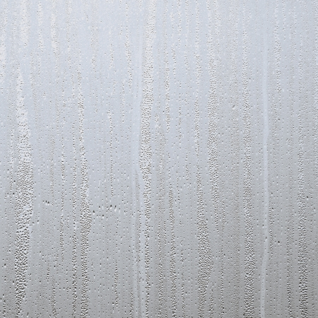 opaque: Closeup of water drops on steamed up window