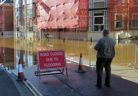 Road closed sign in flooded street  York, North Yorkshire, UK