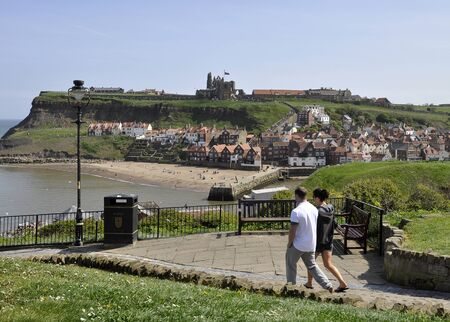 north yorkshire: Young couple walking on path in Whitby, North Yorkshire