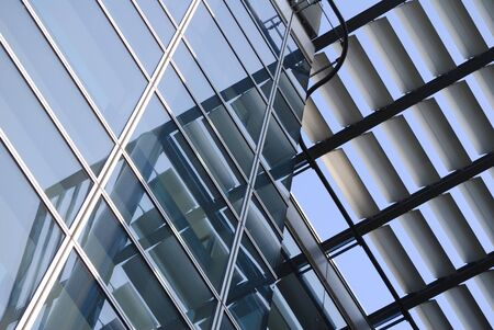 architectural styles: Exterior of modern building showing louvers reflected in windows Stock Photo