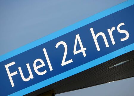 Telephoto view of petrol station fuel sign photo