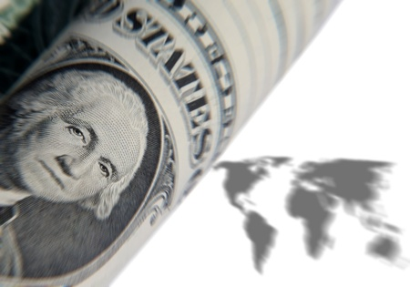 Money concept showing American dollar over world map. Zoom effect applied to eyes. photo