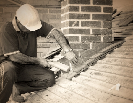 Closeup of trainee roofer on mock building site (sepia toned).