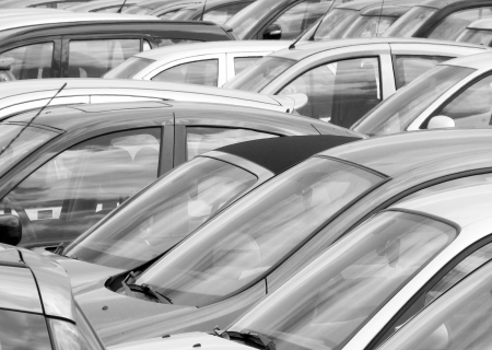 industry park: Telephoto view of crowded car park in city center.