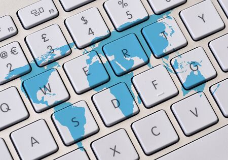 World outline map over blue toned background stock photo picture computer keyboard overlaid with outline world map photo gumiabroncs Gallery