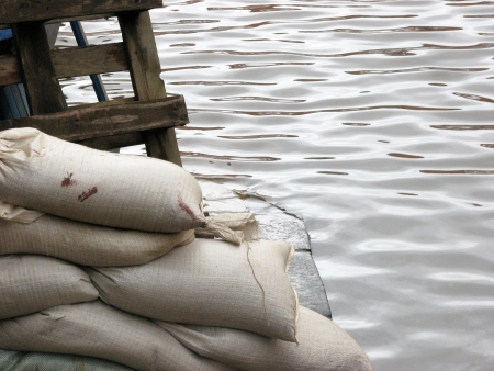 sandbag: Closeup of stacked sandbags on flood York street.