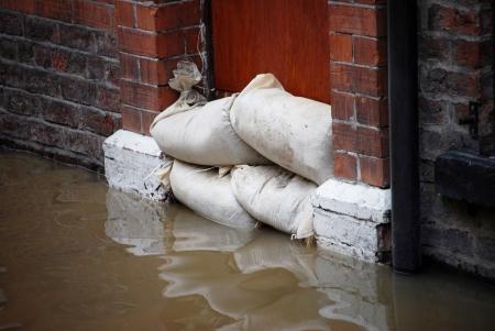 Sandbag barrier in doorway of flooded street in York. photo