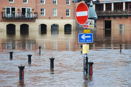 ouse: Submerged road sign on riverside of River Ouse in York