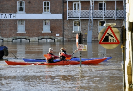 ouse: Two canoeists paddle down flooded River Ouse in York