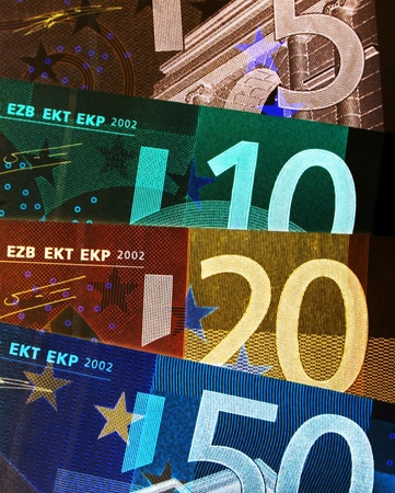 negative equity: Negative image of a selection of Euro currency banknotes