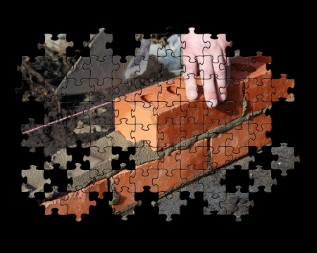 partial: Partial jigsaw puzzle showing builder laying bricks Stock Photo