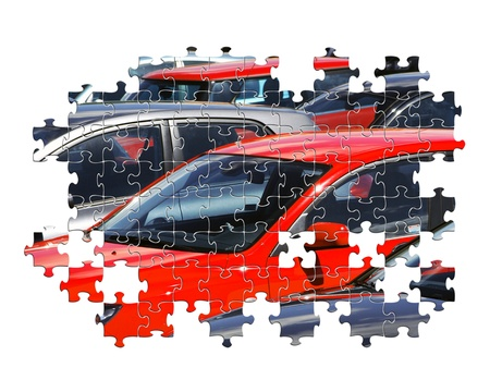 Partially completed jigsaw puzzle of parked cars