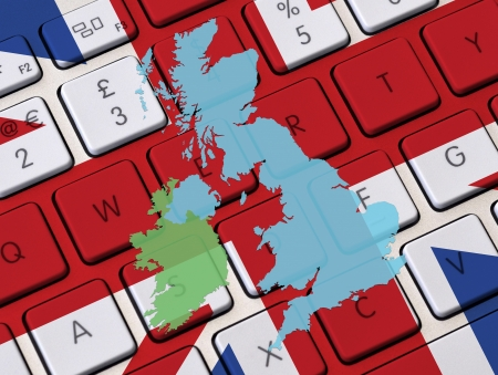 eire: Computer keyboard overlaid with British flag and outline UK map